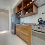 Cozinha fabricada para apartamento de 60M² com gavetões, gavetas, nichos e basculantes